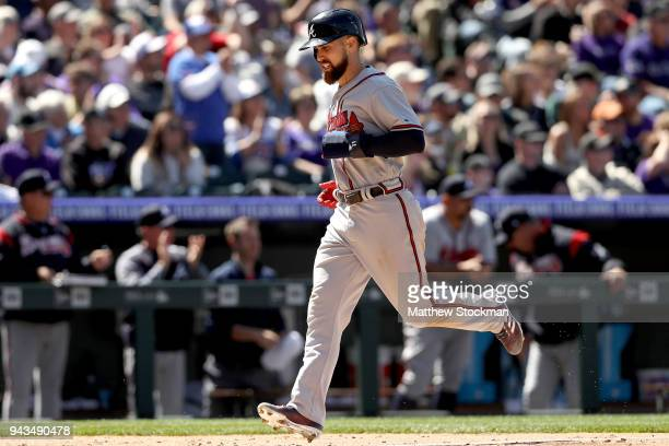 Ender Inciarte of the Atlanta Braves scores on a Ozzie Albies RBI double in the fifth inning against the Colorado Rockies at Coors Field on April 8...