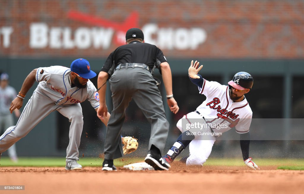 Ender Inciarte #11 of the Atlanta Braves slides in to second base for a seventh inning double against Amed Rosario #1 of the New York Mets at SunTrust Field on June 13, 2018 in Atlanta, Georgia.