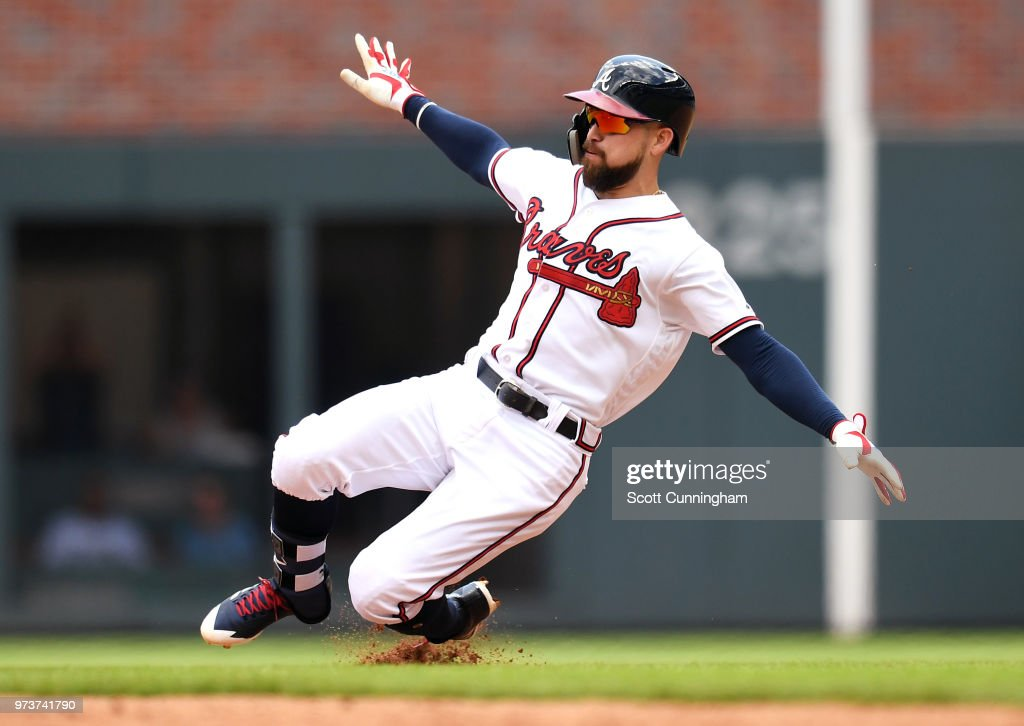 Ender Inciarte #11 of the Atlanta Braves slides in to second base for a seventh inning double against the New York Mets at SunTrust Field on June 13, 2018 in Atlanta, Georgia.