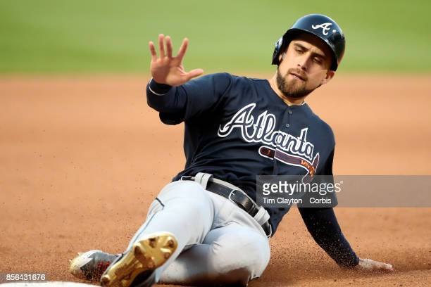 Ender Inciarte of the Atlanta Braves slides into third base during the Atlanta Braves Vs New York Mets MLB regular season game at Citi Field Flushing...