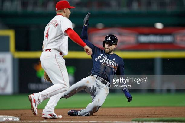 Ender Inciarte of the Atlanta Braves slides safely at third base in the eighth inning of a game against the Cincinnati Reds at Great American Ball...