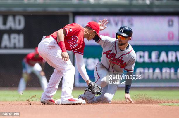 Ender Inciarte of the Atlanta Braves steals second base against Cesar Hernandez of the Philadelphia Phillies in the top of the first inning in game...