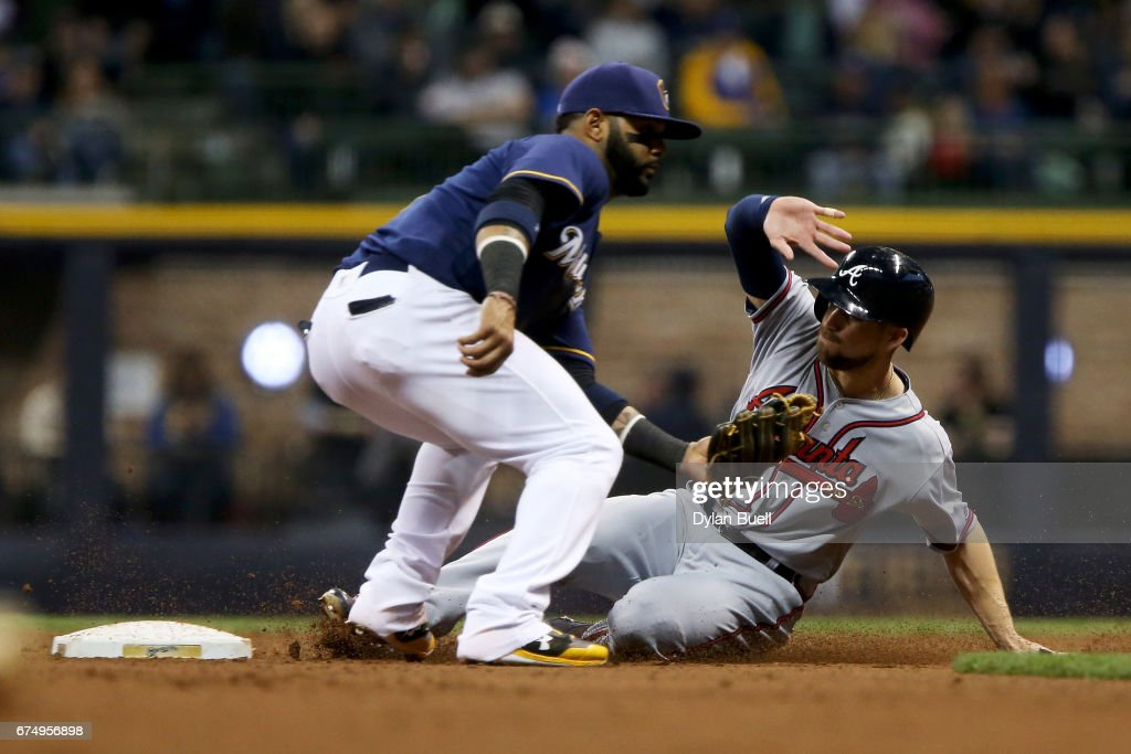 Ender Inciarte #11 of the Atlanta Braves steals second base past Jonathan Villar #5 of the Milwaukee Brewers in the third inning at Miller Park on April 29, 2017 in Milwaukee, Wisconsin.