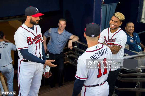 Ender Inciarte of the Atlanta Braves talks to Atlanta United forward Josef Martinez before throwing out the first pitch against the Washington...