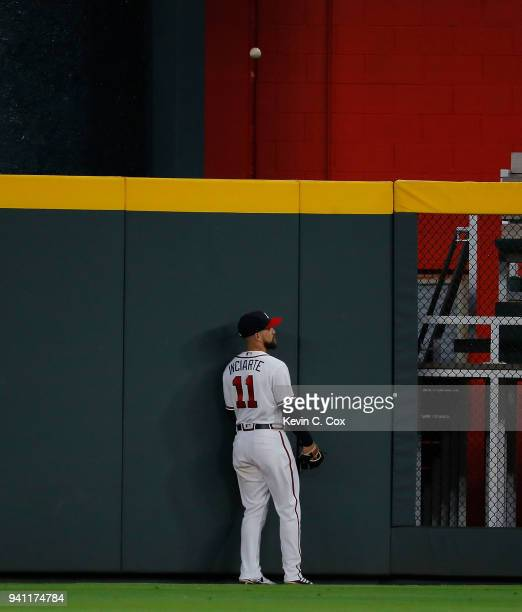 Ender Inciarte of the Atlanta Braves watches as a threerun homer hit by Bryce Harper of the Washington Nationals flys over the outfield wall in the...