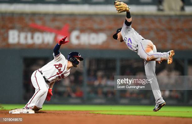 Ender Inciarte the Atlanta Braves is tagged out on a sixth inning steal attempt by Trevor Story of the Colorado Rockies at SunTrust Park on August 18...