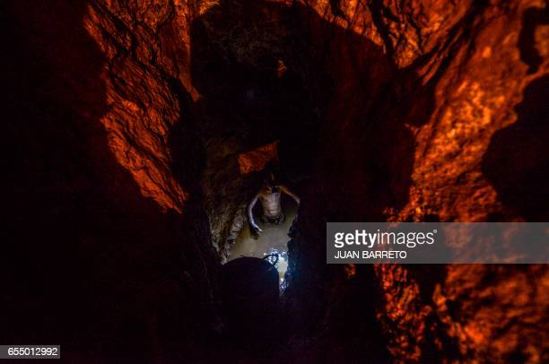 Ender Moreno looks for gold at La Culebra gold mine in El Callao Bolivar state southeastern Venezuela on March 1 2017 Although life in the mines of...