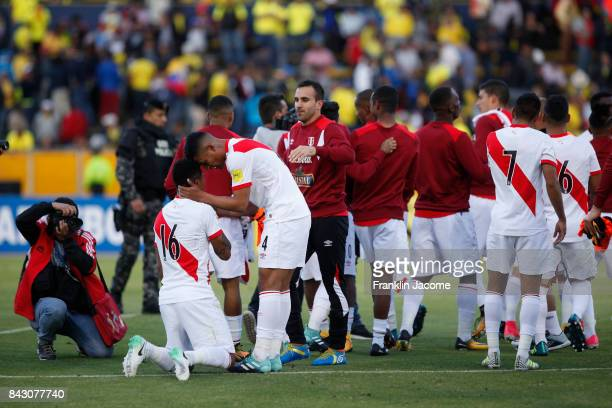 Enderson Santamaría and Wilder Cartagena of Peru celebrate at the end of a match between Ecuador and Peru as part of FIFA 2018 World Cup Qualifiers...