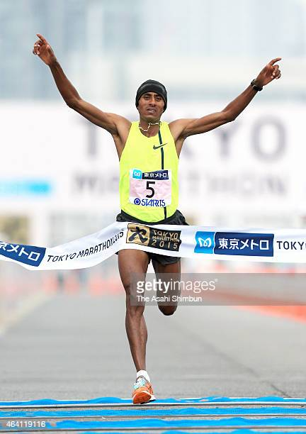 Endeshaw Negesse of Ethopia cross the finishing tape to win the Tokyo Marathon 2015 at Tokyo Big Sight on February 22 2015 in Tokyo Japan