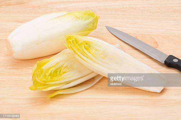 Endives on a wooden cutting board