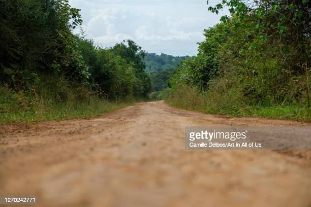 Endless dusty road in african countryside on Septembre 25, 2018 in Bunjako island, Mpigi district, Uganda.