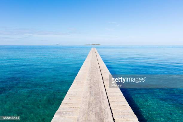 endless jetty to the horizon noumea new caledonia - eternity stock pictures, royalty-free photos & images