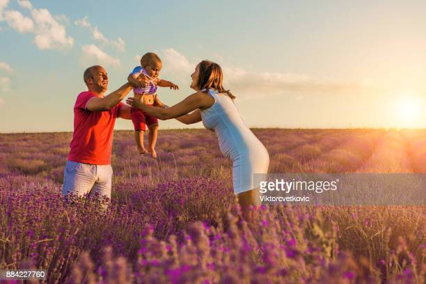 Endless love. Family in lavender field at sunset.