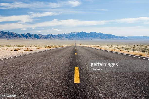 endless road, rt 375 nevada - nevada stock pictures, royalty-free photos & images