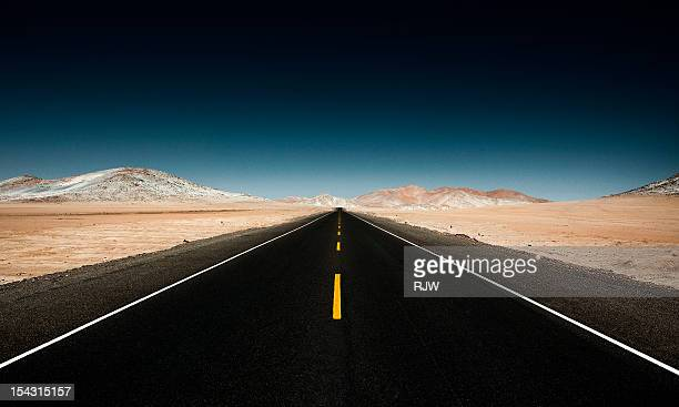 Endless Straight Road through Desert Mountains