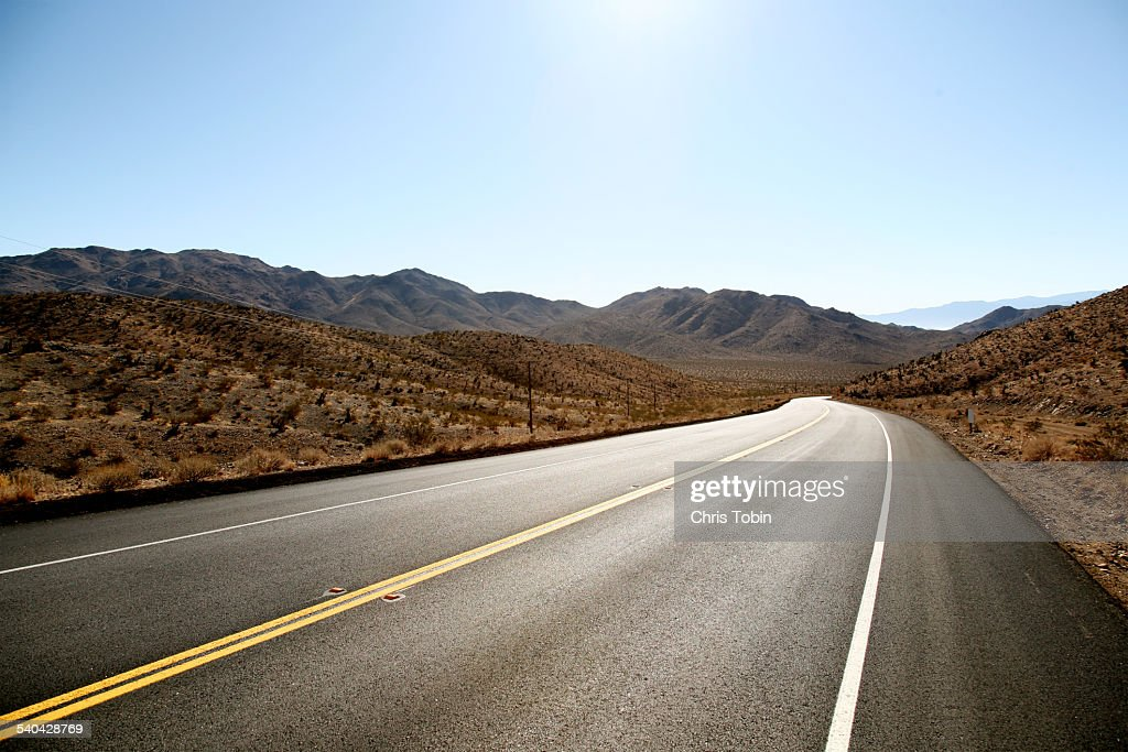 endless street in the desert mountain : Stock Photo