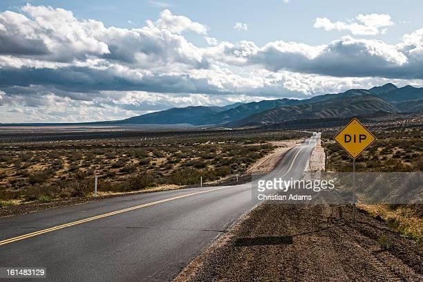 Endless sunny desert road