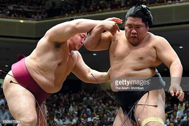Endo pushes Nishikigi out of the ring to win during day five of the Grand Sumo Summer Tournament at Ryogoku Kokugikan on May 12 2016 in Tokyo Japan
