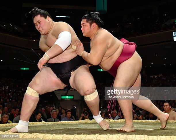 Endo sends Mongolian ozeki Terunofuji out of the ring to win during day thirteen of the Grand Sumo New Year Tournament at Ryogoku Kokugikan on...