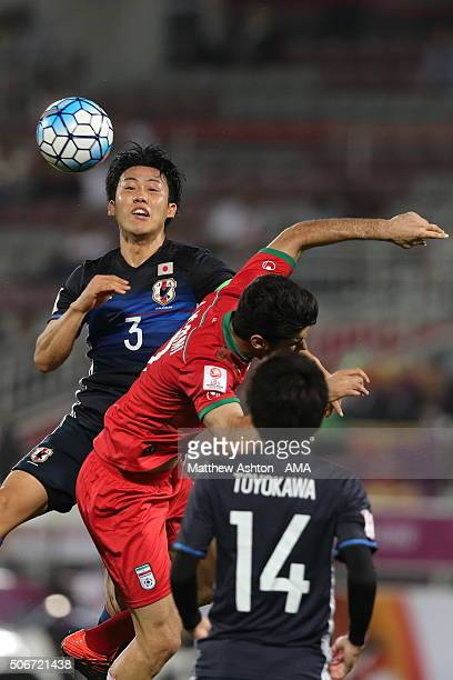 Endo Wataru of Japan and Ali Karimi of Iran during the AFC U23 Championship quarter final match between Japan and Iran at the Abdullah Bin Khalifa...