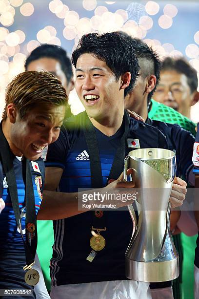Endo Wataru of Japan lifts the trophy after the AFC U23 Championship final match between South Korea and Japan at the Abdullah Bin Khalifa Stadium on...