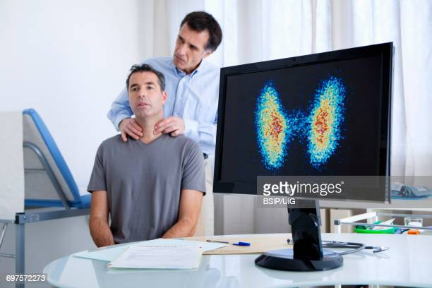 endocrinology consultation man - thyroid gland stock pictures, royalty-free photos & images