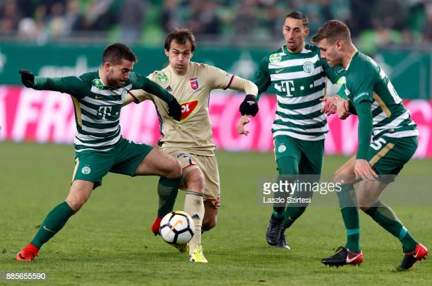 Endre Botka of Ferencvarosi TC fights for the ball with Danko Lazovic of Videoton FC next to Leandro De Almeida 'Leo' of Ferencvarosi TC and Miha...