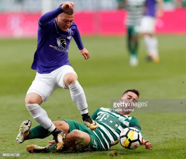 Endre Botka of Ferencvarosi TC slide tackles Donat Zsoter of Ujpest FC during the Hungarian OTP Bank Liga match between Ferencvarosi TC and Ujpest FC...