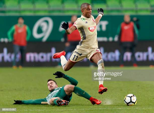 Endre Botka of Ferencvarosi TC slide tackles Loic Nego of Videoton FC during the Hungarian OTP Bank Liga match between Ferencvarosi TC and Videoton...