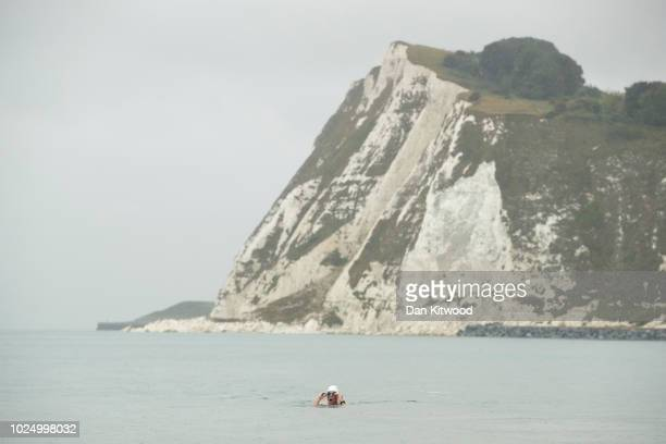 Endurance swimmer Lewis Pugh arrives on Shakespeare Beach after completing his 350 mile swim along the English Channel on August 29 2018 in Dover...