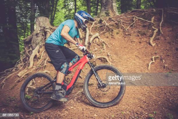 Enduro All Mountain E bike rider - adrenaline MTB woods trail