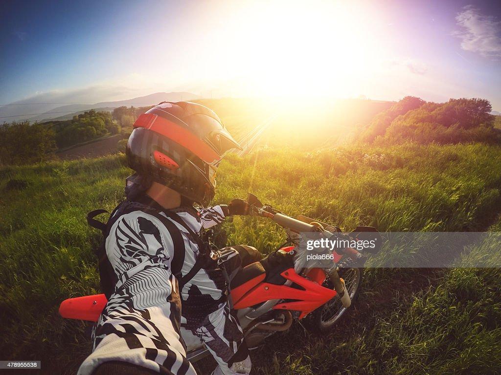 Enduro Motocross rider taking a selfie : Stock Photo