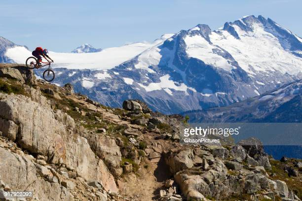 enduro mountain bike rider - snowcapped mountain stock pictures, royalty-free photos & images