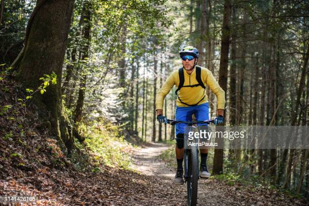 mtb enduro mountain biking in a pristine forest - cross country cycling stock pictures, royalty-free photos & images