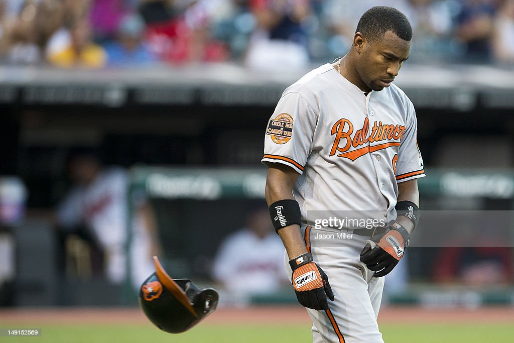 Endy Chavez #9 of the Baltimore Orioles reacts after striking out during the fifth inning against the Cleveland Indians at Progressive Field on July 23, 2012 in Cleveland, Ohio.