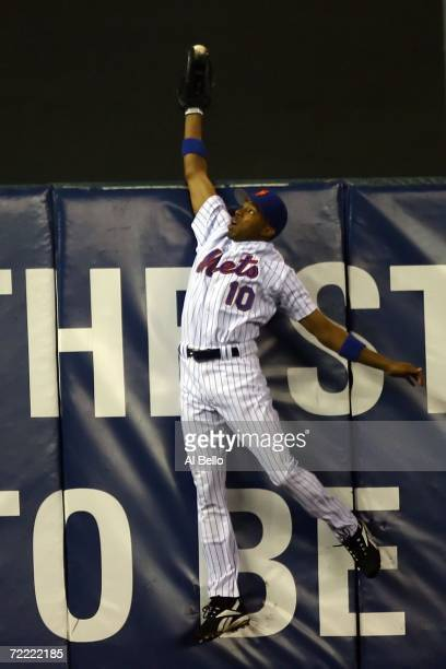 Endy Chavez of the New York Mets catches a ball hit in the sixth inning hit by Scott Rolen of the St Louis Cardinals during game seven of the NLCS at...