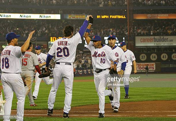 Endy Chavez of the New York Mets high fives Shawn Green after catching the final out of the sixth inning against the St. Louis Cardinals during game...
