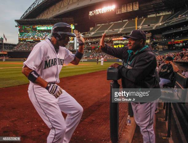 Endy Chavez of the Seattle Mariners is congratulated by manager Lloyd McClendon after hitting a home run in the fourth inning against the Chicago...