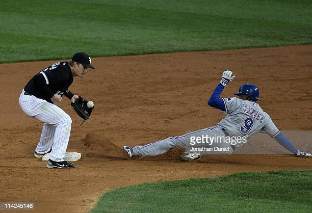Endy Chavez of the Texas Rangers beats a throw to Gordon Beckham of the Chicago White Sox for a stolen base at U.S. Cellular Field on May 16, 2011 in...