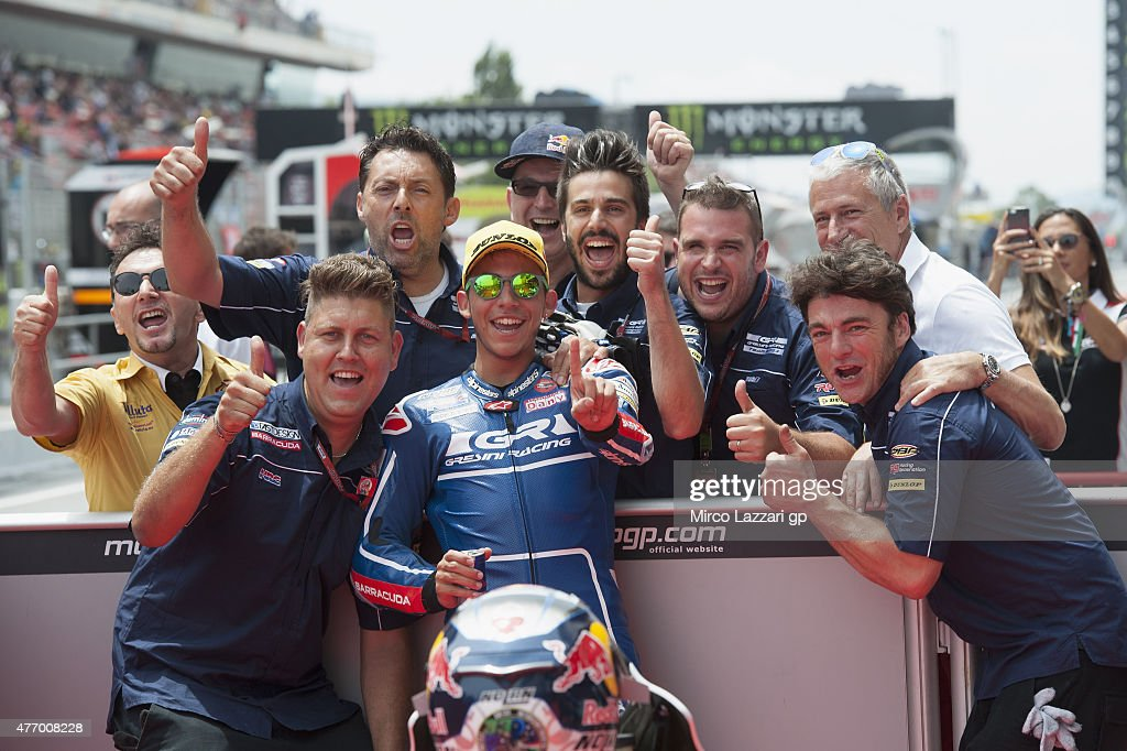 Enea Bastianini of Italy and Junior Team Gresini Moto3 celebrates the pole position with team at the end of the MotoGp of Catalunya - Qualifying at Circuit de Catalunya on June 13, 2015 in Montmelo, Spain.