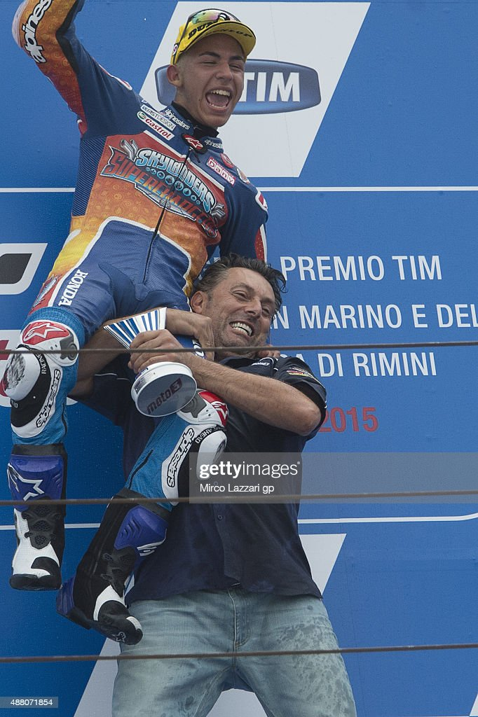 Enea Bastianini of Italy and Junior Team Gresini Moto3 celebrates the victory on the podium at the end of the Moto3 World Championship race during the San Marino GP at Misano World Circuit on September 13, 2015 in Misano Adriatico, Italy.