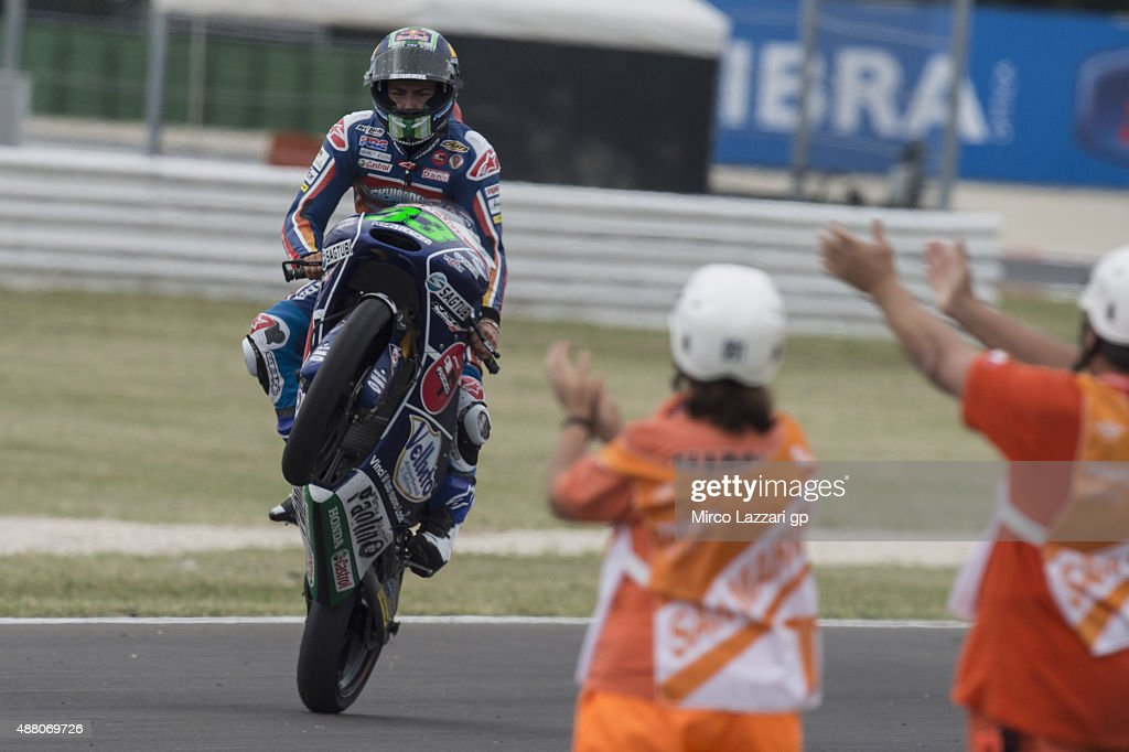 Enea Bastianini of Italy and Junior Team Gresini Moto3 pulls a wheelie as he celebrates the victory at the end of the Moto3 World Championship race during the San Marino GP at Misano World Circuit on September 13, 2015 in Misano Adriatico, Italy.