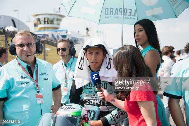 Enea Bastianini of Italy and Leopard Racing Moto3 speaks with journalists and prepares to start on the grid during the Moto3 race during the MotoGp...