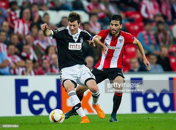 Eneko Boveda of Athletic Club duels for the ball with Nikola Ninkovic of FK Partizan during the UEFA Europa League match between Athletic Club and FK...