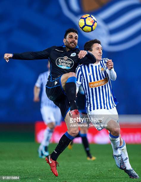 Eneko Boveda of RC Deportivo La Coruna duels for the ball with Willian Mikel Oyarzabal of Real Sociedad during the La Liga match between Real...