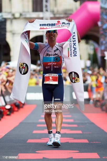 Eneko Llanos of Spain celebrates winning IRONMAN Vitoria on July 14 2019 in Vitoria Spain
