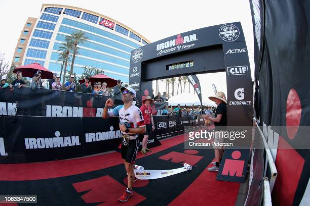Eneko Llanos of Spain crosses the finish line to win the 2018 Ironman Arizona at Tempe Town Lake on November 18, 2018 in Tempe, Arizona.