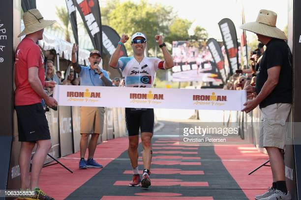 Eneko Llanos of Spain crosses the finish line to win the Top Pro Men's division of the 2018 Ironman Arizona at Tempe Town Lake on November 18 2018 in...
