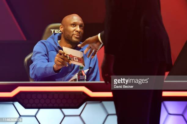 Enemies cocaptain Lamar Odom hands in a draft pick during the BIG3 Draft at the Luxor Hotel Casino on May 01 2019 in Las Vegas Nevada