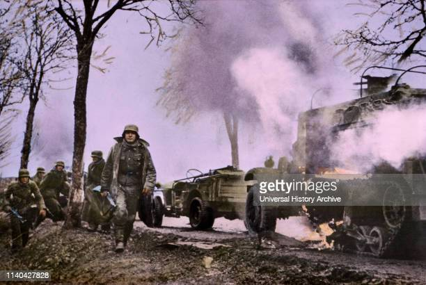 Enemy Troops Passing Burning US Equipment ArdennesAlsace Campaign Battle of the Bulge1945